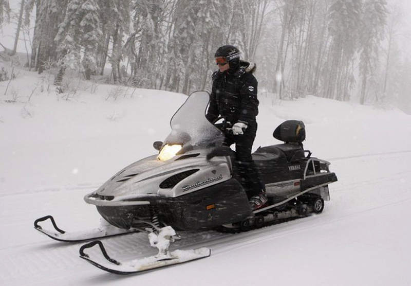 Russian Prime Minister Vladimir Putin drives a snowmobile at Russia's ski resort Krasnaya Polyana near Sochi