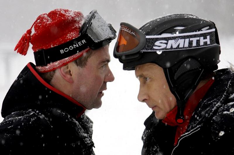 Russian President Dmitry Medvedev and Prime Minister Vladimir Putin talk at Russia's ski resort Krasnaya Polyana near Sochi