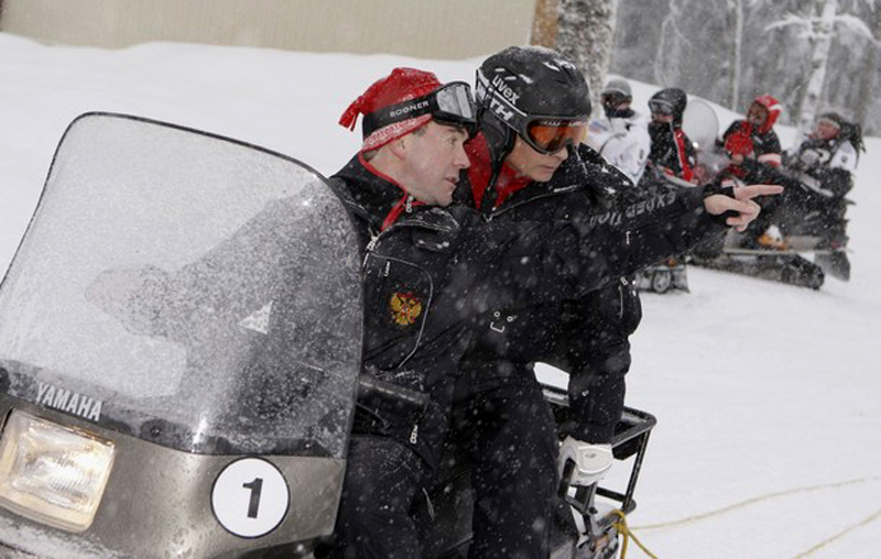 Russian Prime Minister Vladimir Putin and President Dmitry Medvedev ride a snowmobile at Russia's ski resort Krasnaya Polyana near Sochi