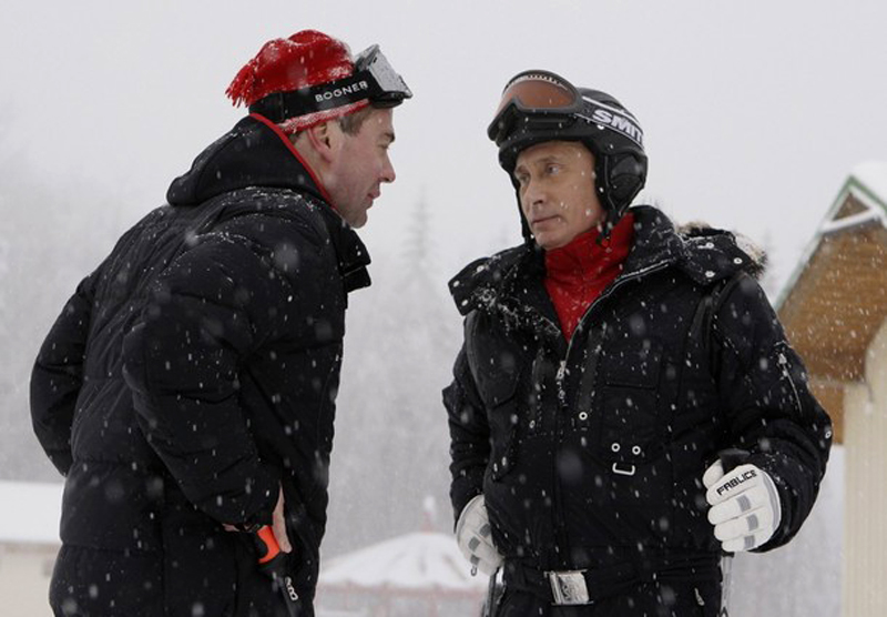Russian President Dmitry Medvedev and Prime Minister Vladimir Putin talk at Russia's ski resort Krasnaya Polyana near Sochi