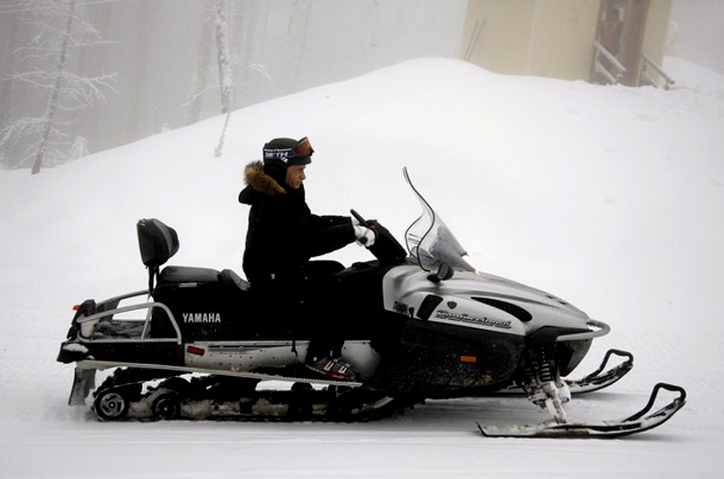 Russian Prime Minister Vladimir Putin drives a snowmobile at Russia's ski resort Krasnaya Polyana near Sochi