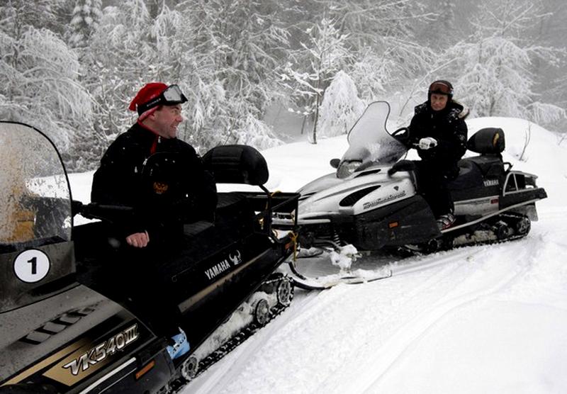Russian Prime Minister Vladimir Putin and President Dmitry Medvedev drive snowmobiles at Russia's ski resort Krasnaya Polyana near Sochi